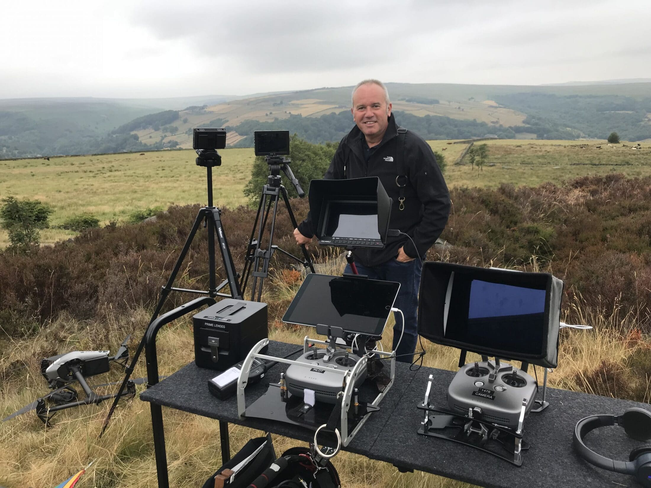 Darren Miller filming with Halo Vue, stood with Drone remote control. DJI Inspire 2 Aircraft , directors monitors in the country side