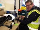 Nick director downloading footage whilst sat with our dji inspire aircraft, drone